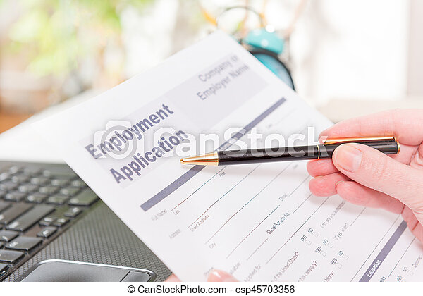 Holding blank employment application form - csp45703356
