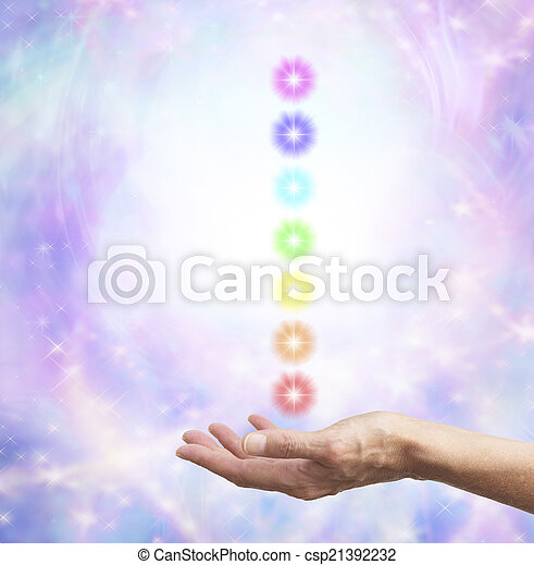 Holding chakra energy in open hand  - csp21392232