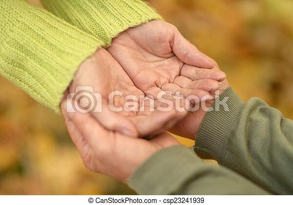Holding hands - csp23241939