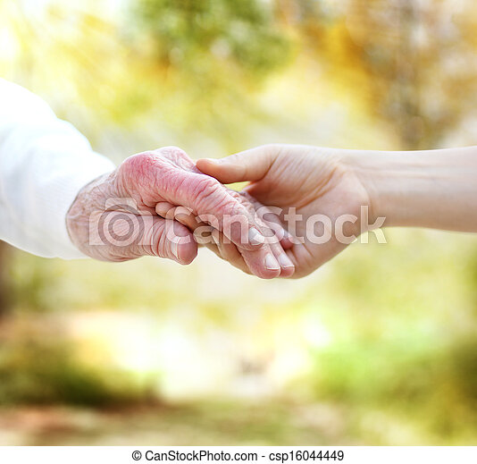 Holding hands with senior - csp16044449