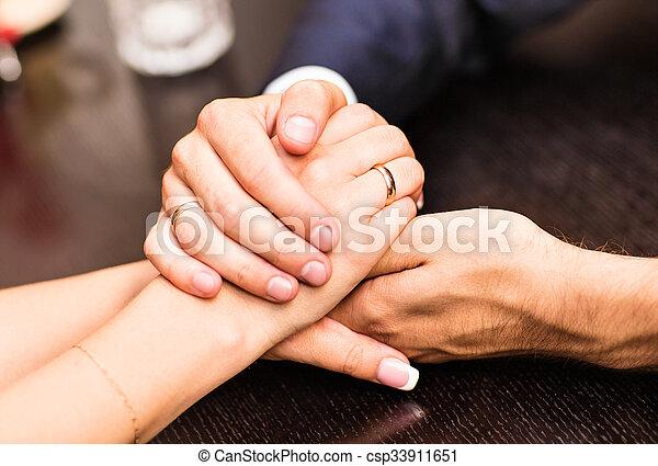Holding Men And Women Hands Wedding Rings