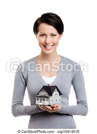 Holding small toy house in front of herself - csp10414018