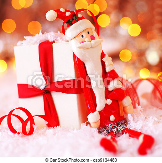 Holiday Christmas background with cute Santa decoration - csp9134480