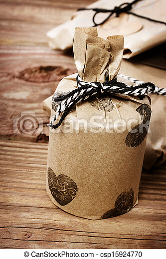 Holiday presents wraped in a rustic earthy style - csp15924770