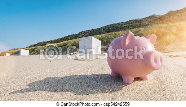 Holiday savings piggy bank on a beach - csp54242559