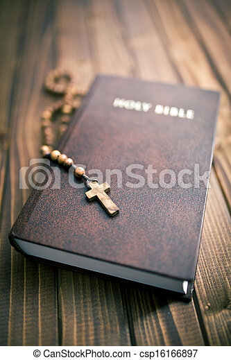 holy bible with rosary beads - csp16166897