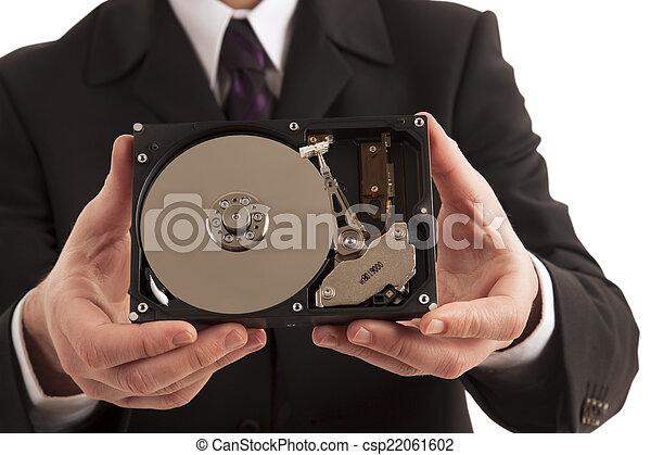 Hombre de negocios mostrando disco duro - csp22061602