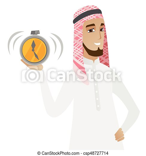 Hombre de negocios musulmán sosteniendo despertador. - csp48727714