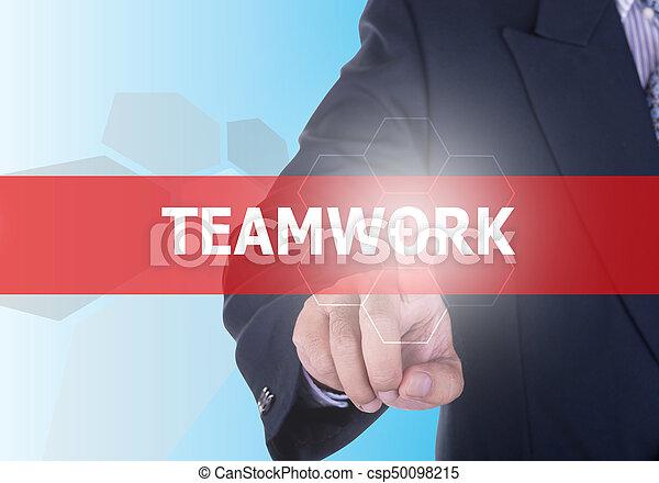 Hombre de negocios pulsando botón de trabajo en equipo - csp50098215