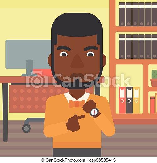 Un hombre de negocios enfadado apuntando a un reloj. - csp38585415