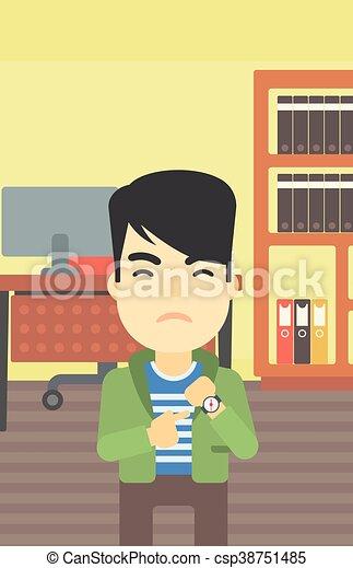 Un hombre de negocios enfadado apuntando a un reloj. - csp38751485