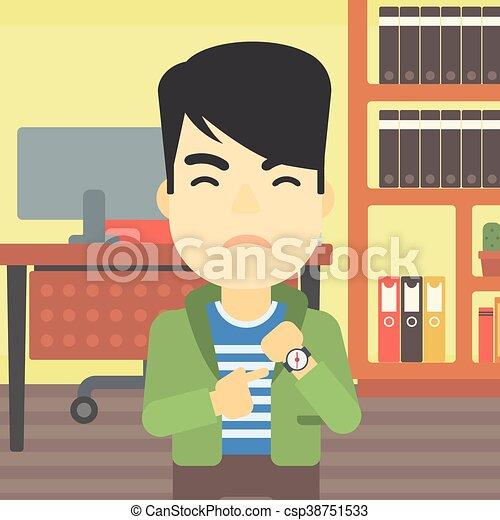 Un hombre de negocios enfadado apuntando a un reloj. - csp38751533