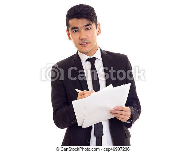 Un joven vestido con papeles - csp46907236
