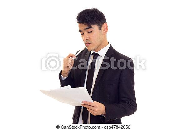 Un joven vestido con papeles - csp47842050