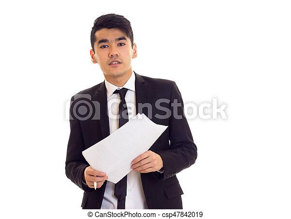 Un joven vestido con papeles - csp47842019