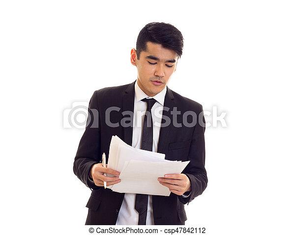Un joven vestido con papeles - csp47842112