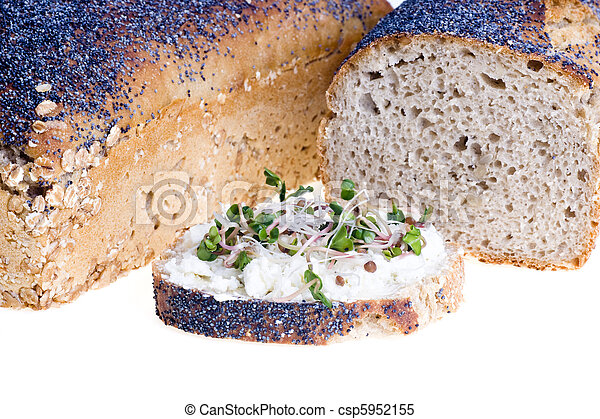 Home a loaf of rye bread with seeds and poppy seeds - csp5952155