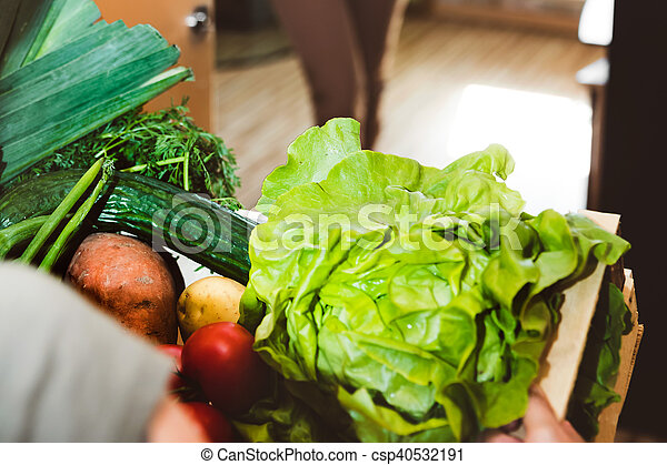 Home delivery of fresh vegetables, grocery box - csp40532191