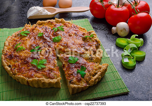 Home French quiche stuffed with mushrooms, tomato and leek - csp22737393