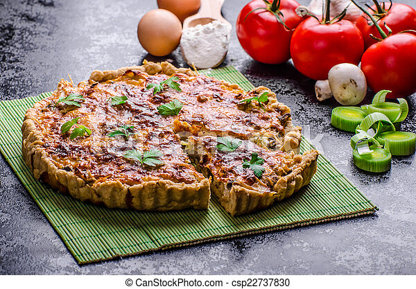 Home French quiche stuffed with mushrooms, tomato and leek - csp22737830