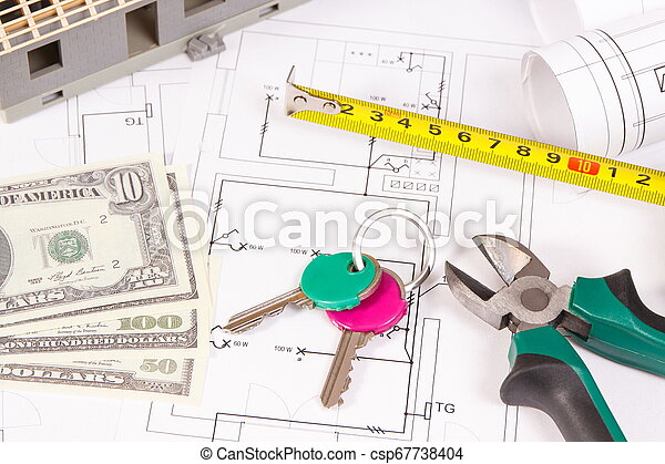 Home keys, money, electrical diagrams and work tools for engineer jobs, building home cost concept - csp67738404