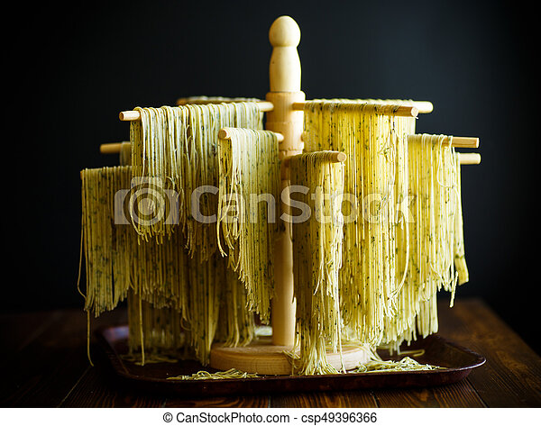 Home-made noodles with greens - csp49396366