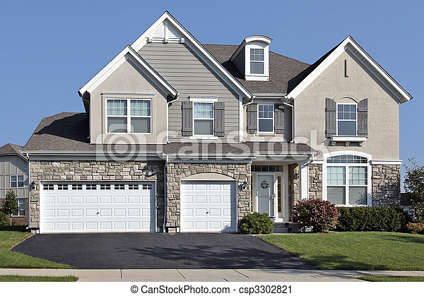 Home with three car stone garage - csp3302821