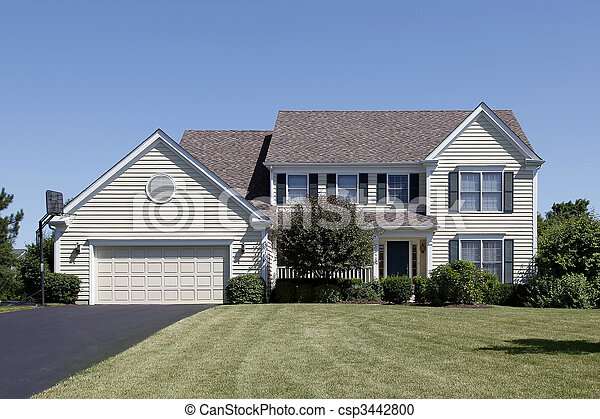 Home with yellow siding - csp3442800