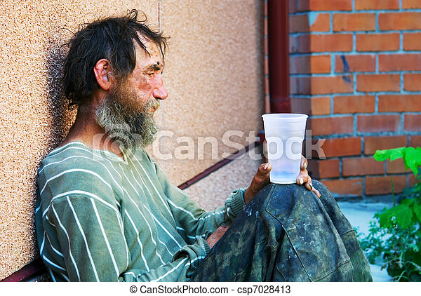 Homeless alcoholic in depression - csp7028413