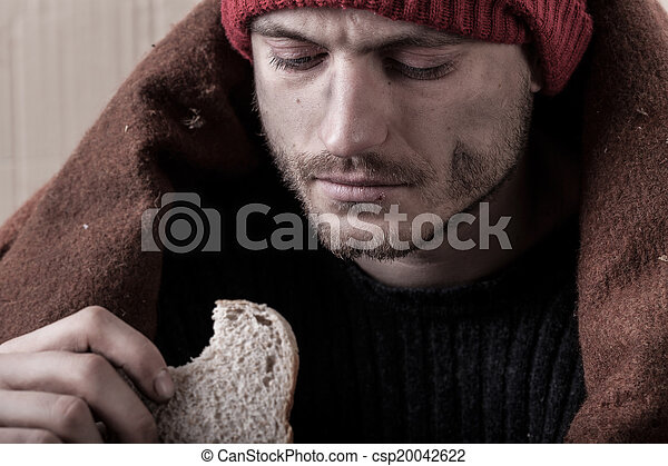 Homeless and poor man eating sandwich - csp20042622