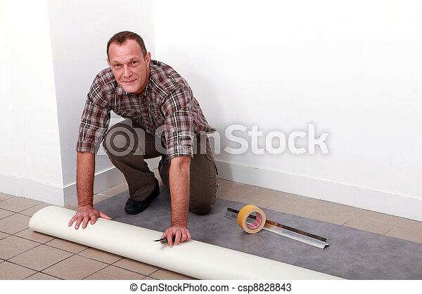 homem coloca, tapete - csp8828843