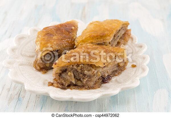 Homemade baklava dessert on a plate - csp44972062
