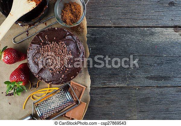homemade chocolate cake recipe border background from above - csp27869543