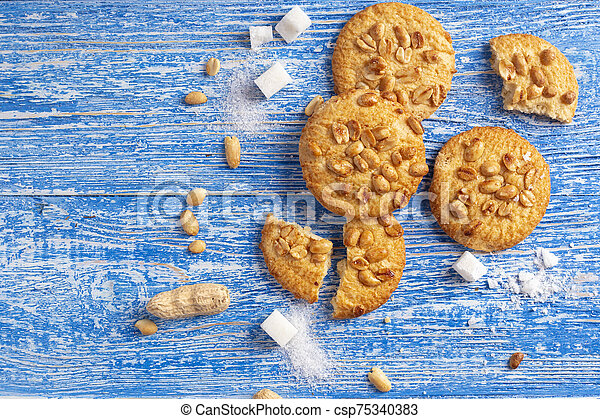homemade cookies with peanuts on the table - csp75340383