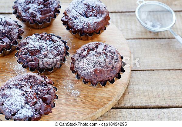 Homemade cupcakes with chocolate chunks - csp18434295