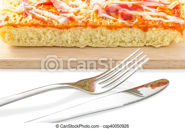 Homemade delicious fresh a slice of pizza on wooden plate. - csp40050926