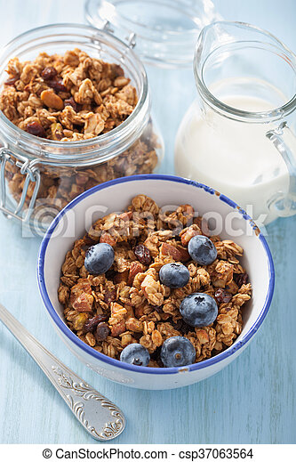 homemade healthy granola with blueberry for breakfast - csp37063564