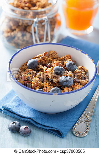homemade healthy granola with blueberry for breakfast - csp37063565