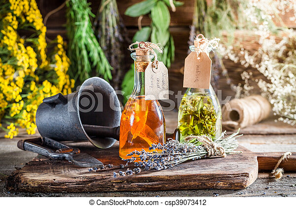 Homemade herbs in bottles as an alternative cure - csp39073412