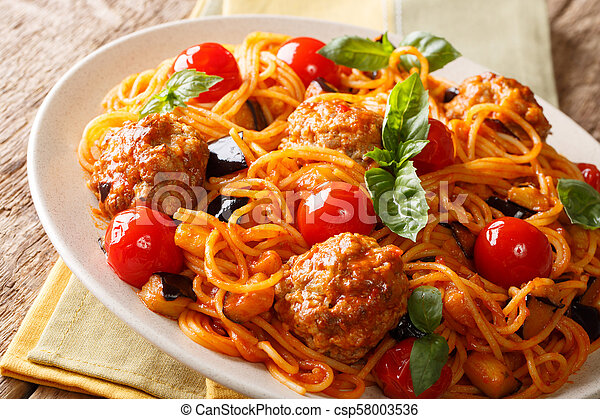 Homemade meat balls with spaghetti, aubergines and tomatoes close-up. horizontal - csp58003536