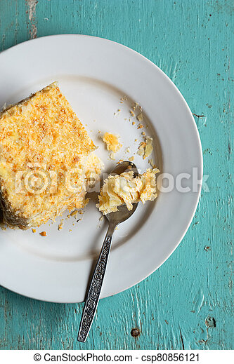 Homemade mille-feuille, puff pastry custard cream pie on blue wooden background, closeup view - csp80856121