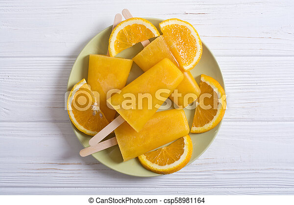 Homemade orange popsicle - csp58981164