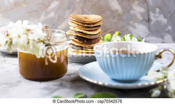 Homemade pancakes stacked on a gray background - csp70342578
