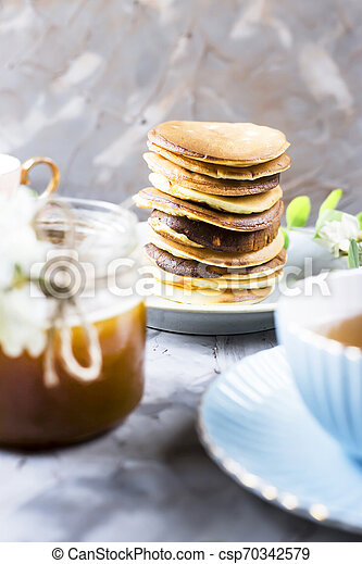 Homemade pancakes stacked on a gray background - csp70342579