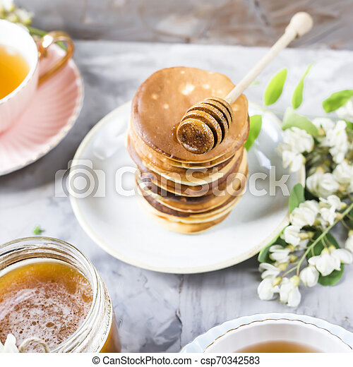 Homemade pancakes stacked on a gray background - csp70342583