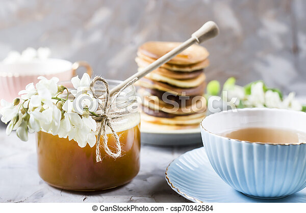 Homemade pancakes stacked on a gray background - csp70342584