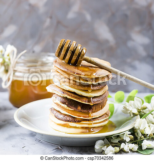 Homemade pancakes stacked on a gray background - csp70342586