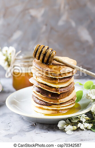 Homemade pancakes stacked on a gray background - csp70342587