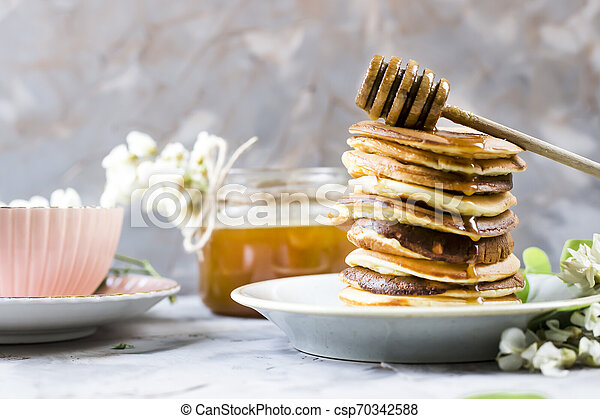 Homemade pancakes stacked on a gray background - csp70342588