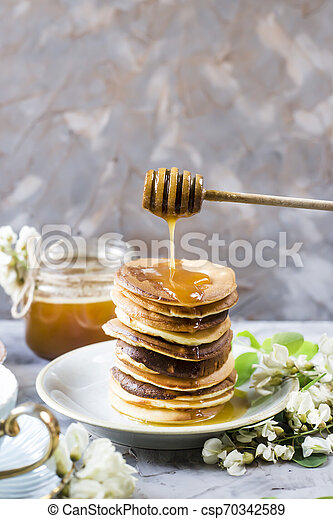 Homemade pancakes stacked on a gray background - csp70342589